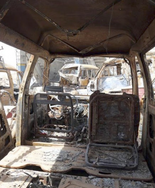 Burned-out cars lined up by the Jarman petrol station, Saada City, Yemen, which was struck in an aerial attack on April 15, 2015. © 2015 Ole Solvang/Human Rights Watch